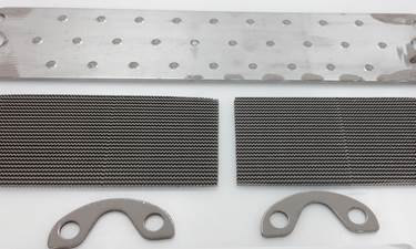 An EGR cooler parts that have been roller coated