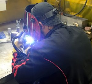 Operator welding a part manufactured at Wall Colmonoy Aerobraze OKC. Wall Colmonoy opens their doors to the local Oklahoma City community on Oct 12, 2018 as part of participating in Manufacturing Day to inspire the next generation.